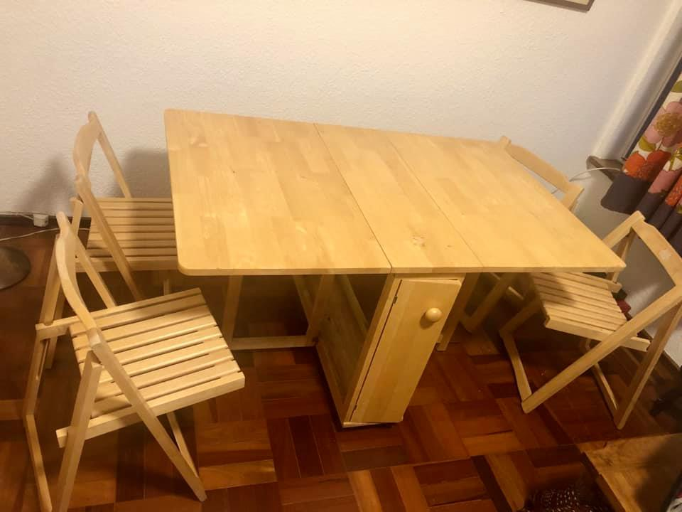 Fold up table with 4 fold up chairs for sale.