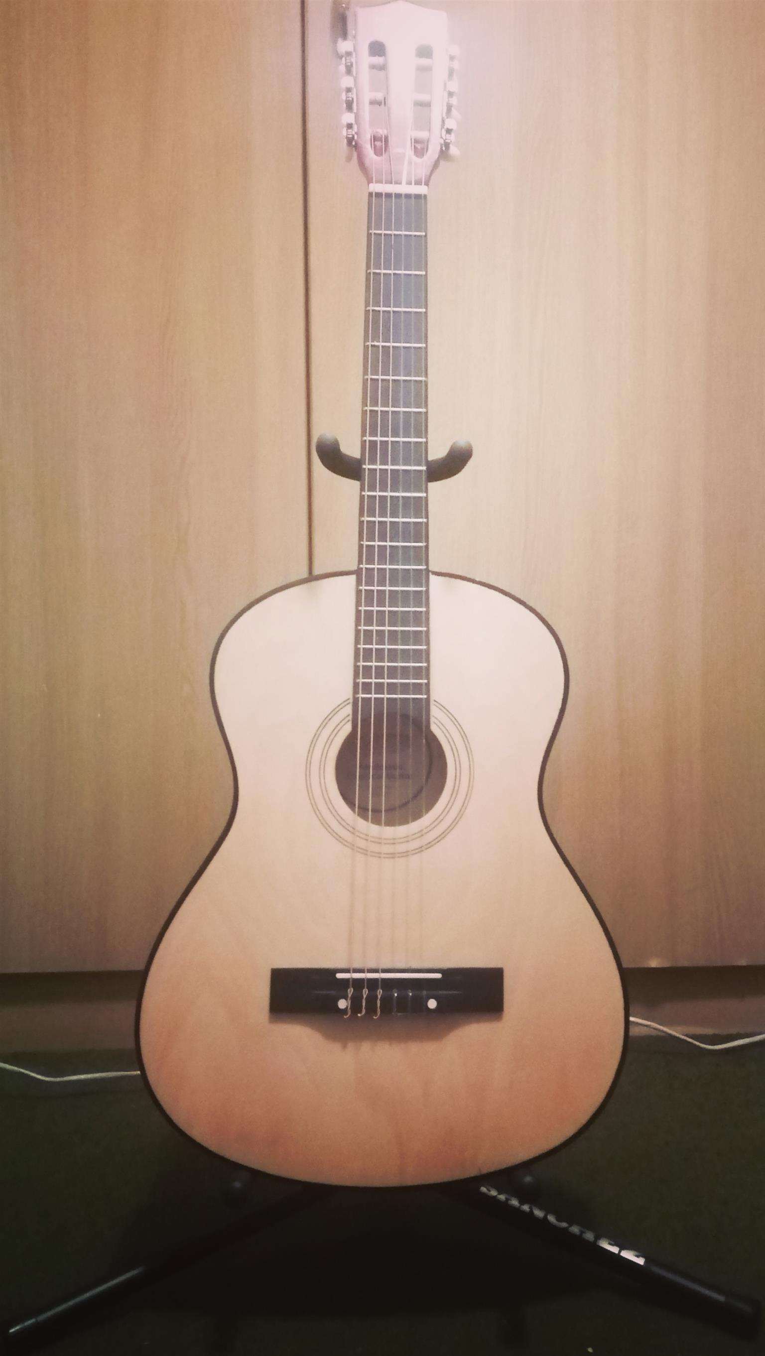 Wooden guitar with red sides