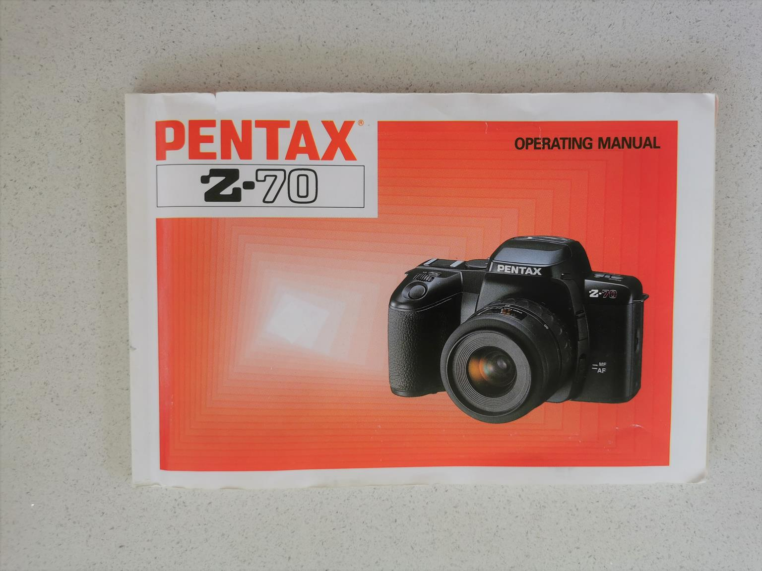 Pentax film Z-70 AF-SLR with accessories in excellent condition.