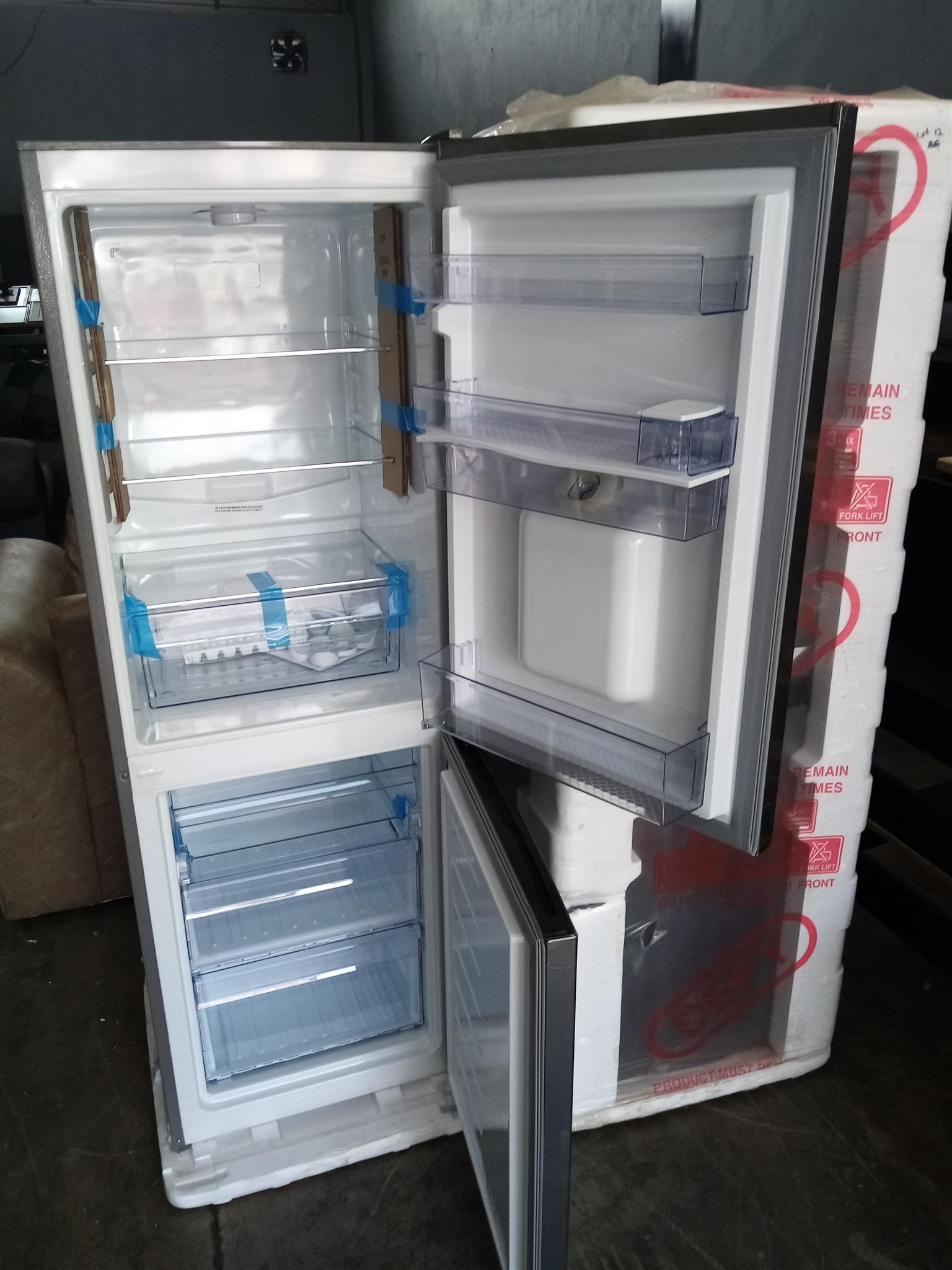 Hi I have a brand new DEFY mettalic fridge with water dispenser