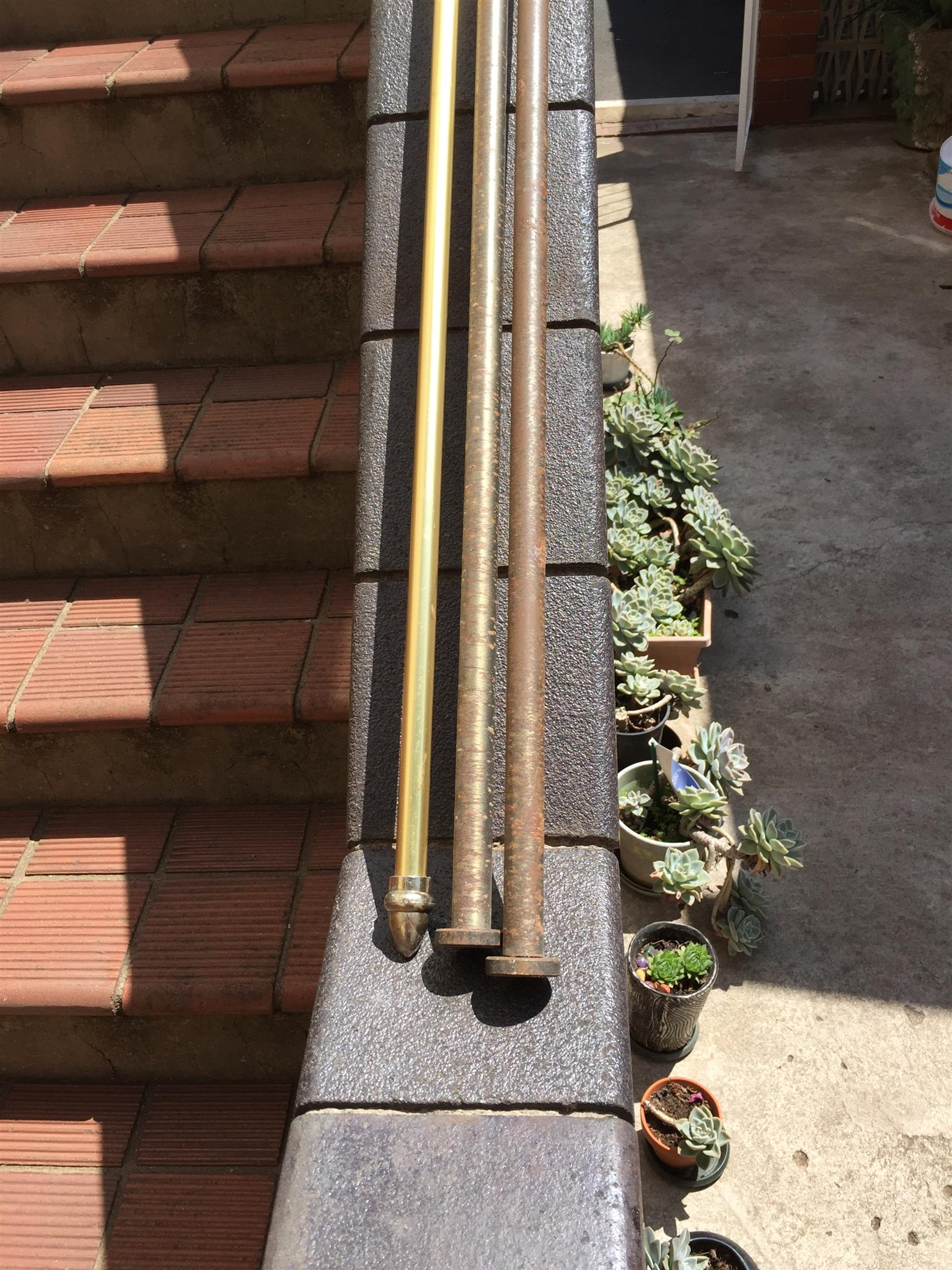 3 Metal Curtain Rails . 2x 1.5m by 3.5cm . Bronze with Finials. 1x3m by 3.5cm Gold with Finials . No brackets. R250 for all 3.