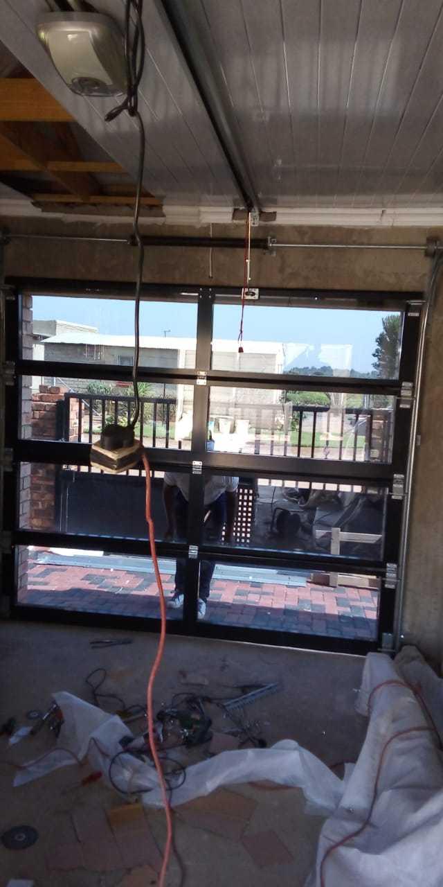 Door Master Garage Door Installation and Repairs