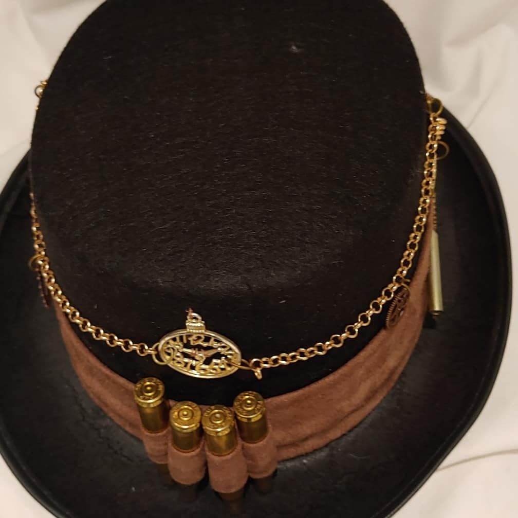 Steampunk tophats, copper Steampunk inspired canes , jewellery, goggles, faux leather bowties etc for Afrikaburn