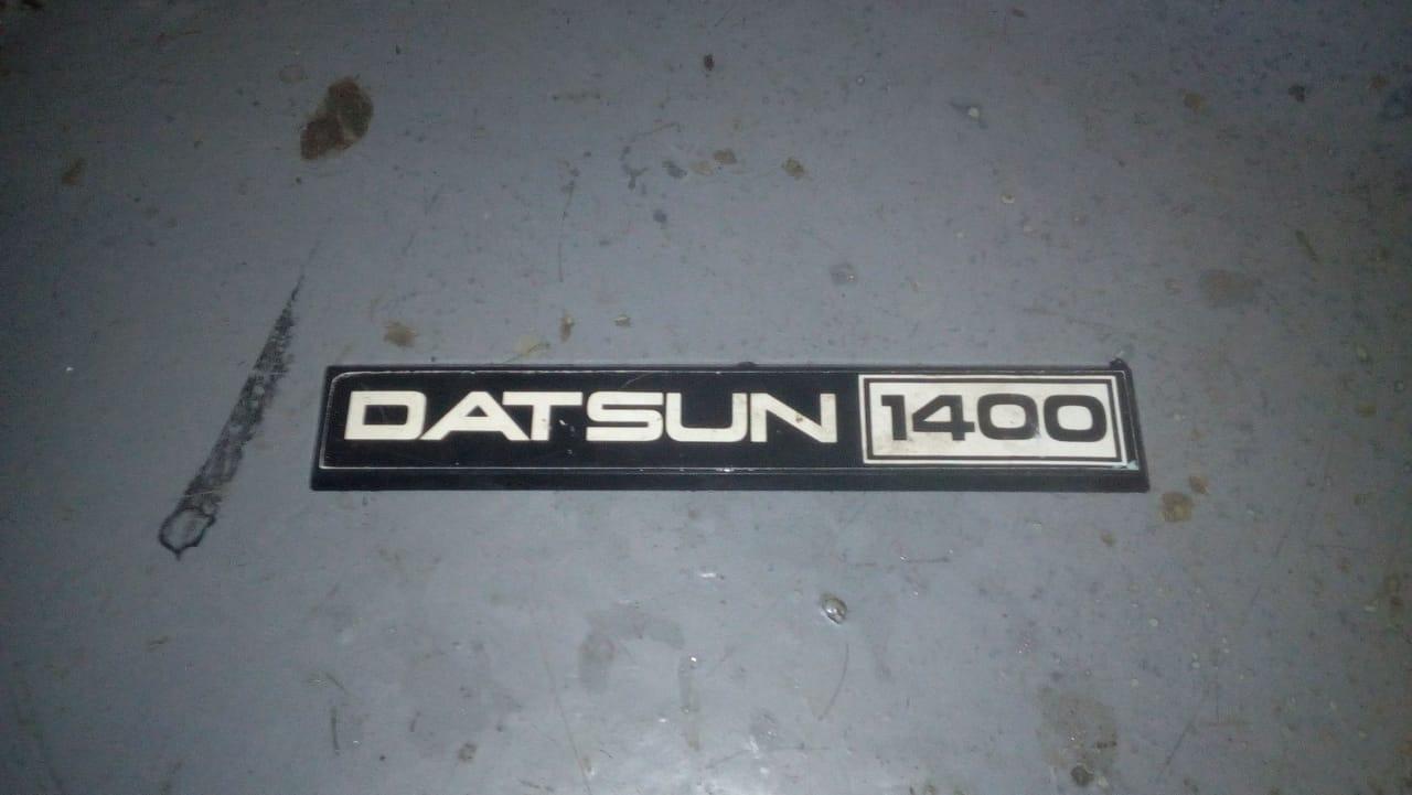 Datsun 1400 badge