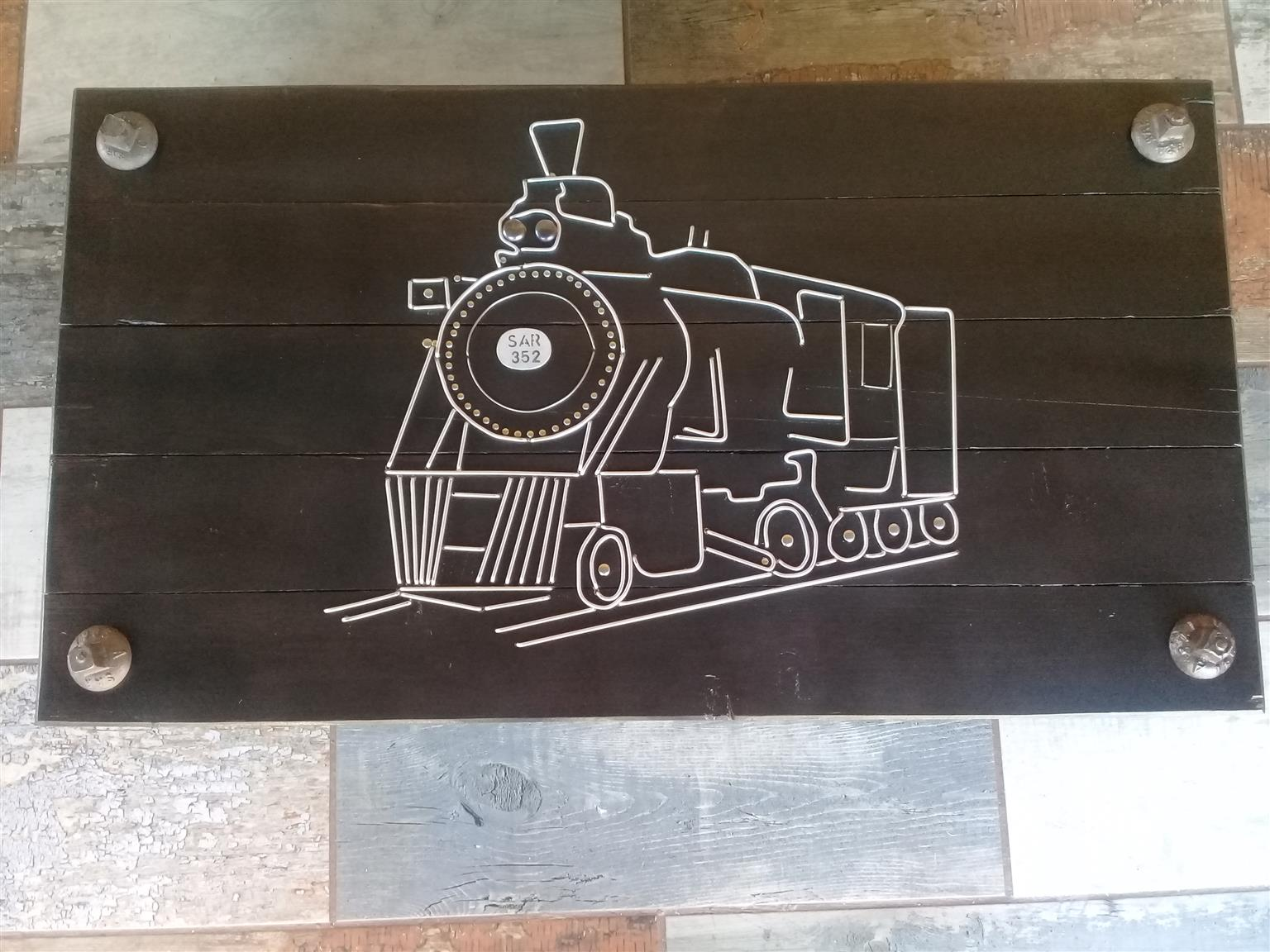 Coffee table solid wood decorated with railway sleeper bolts and steam locomotive table top with alliminium