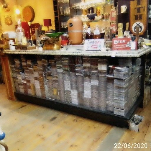 Large wooden bar with marble top. Cabinets and drawers. (CONTENTS NOT INCLUDED)