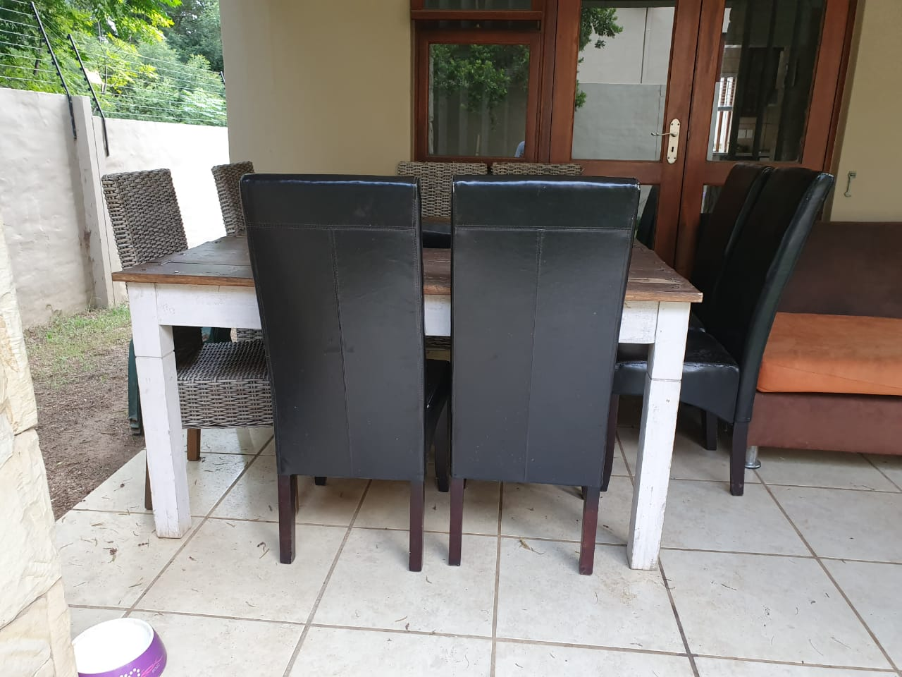 8 seater 1.8m solid wood farm style dining table with 8 chairs.