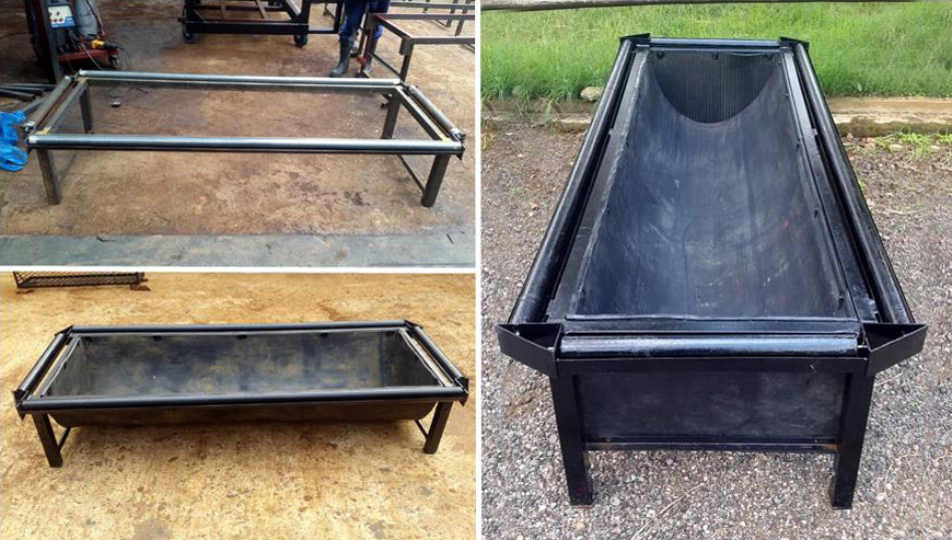 Feeding troughs with dip rollers for tick control