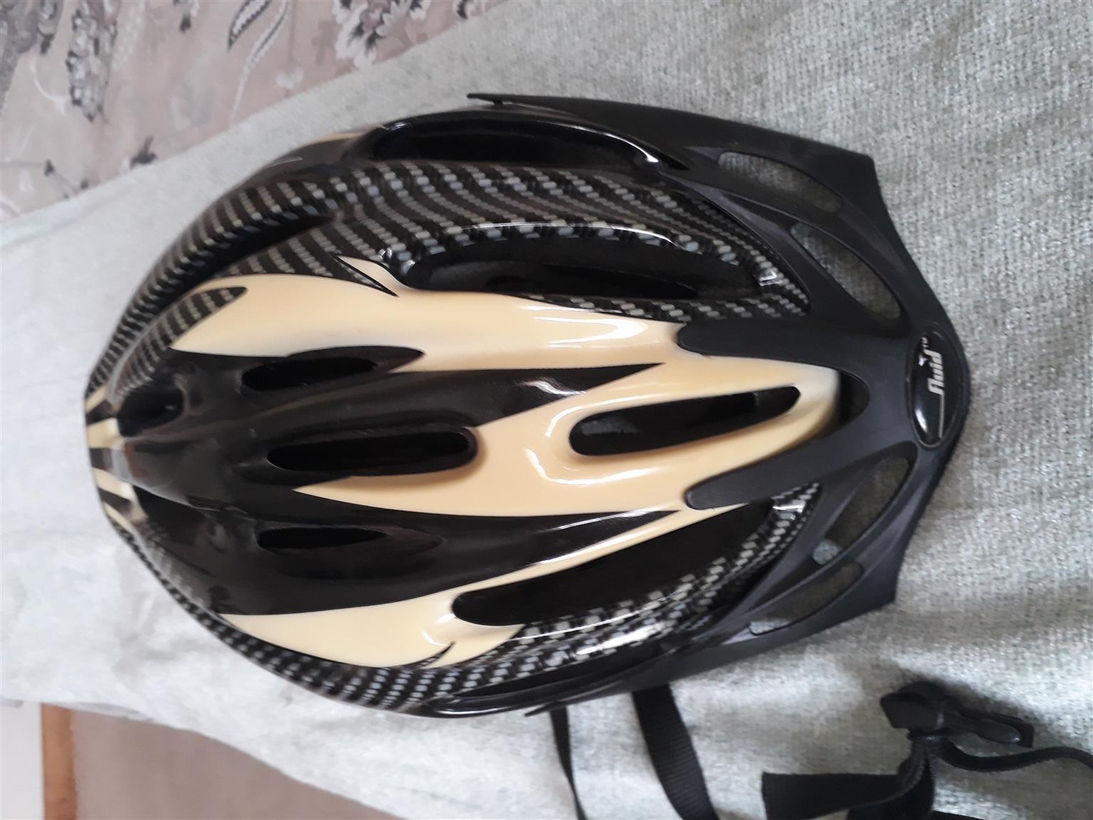 Fluid cycling helmet.