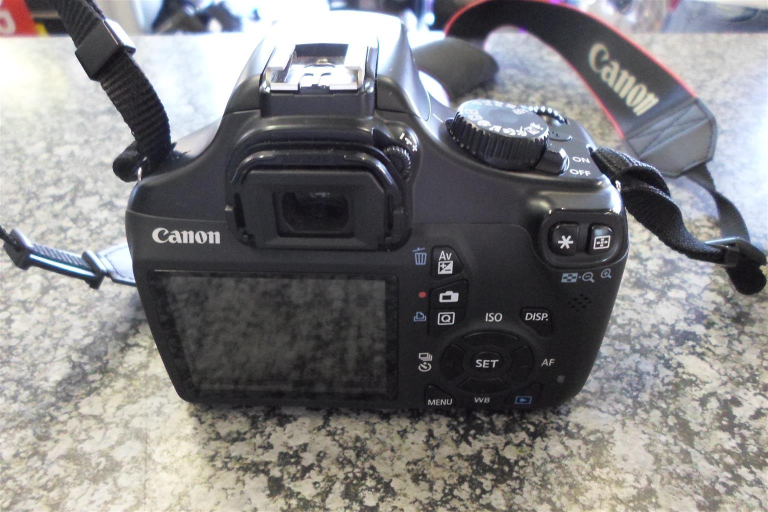 Canon EOS 1100D + Lens