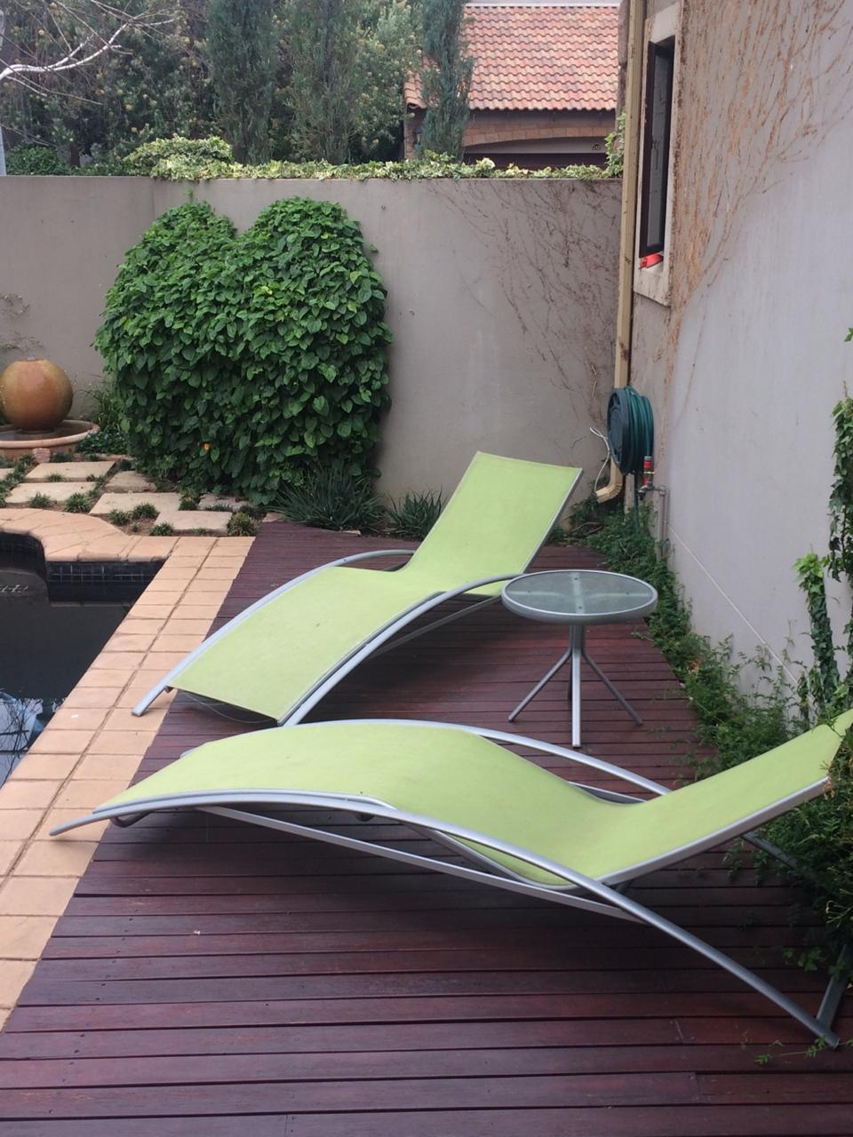 Patio 10 seater table and pool loungers - Patio Warehouse