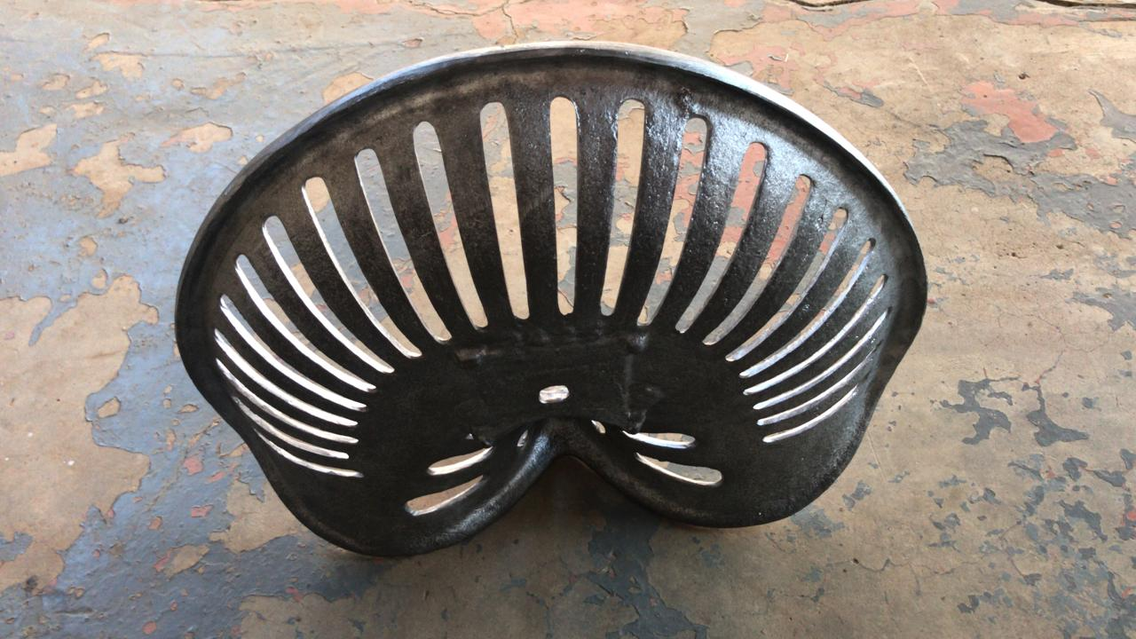 Solid cast iron tractor seats for sale