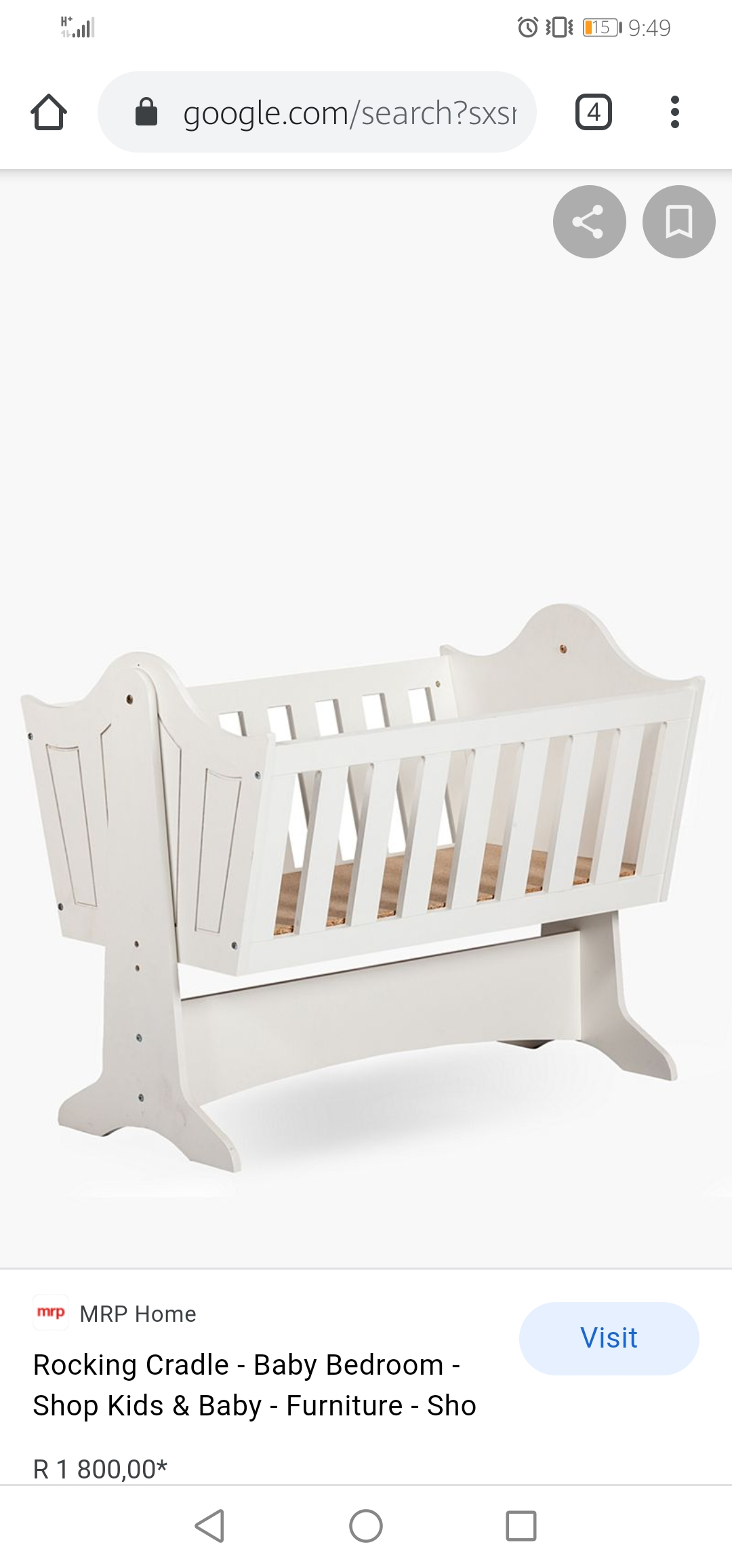 White wooden rocking cot