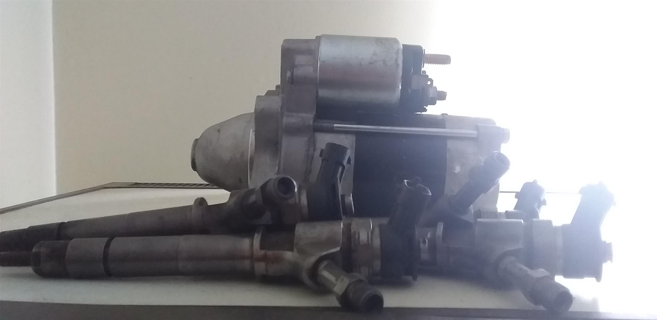 Diesel rail injectors and a starter for a Mazda BT50. A big bargain.