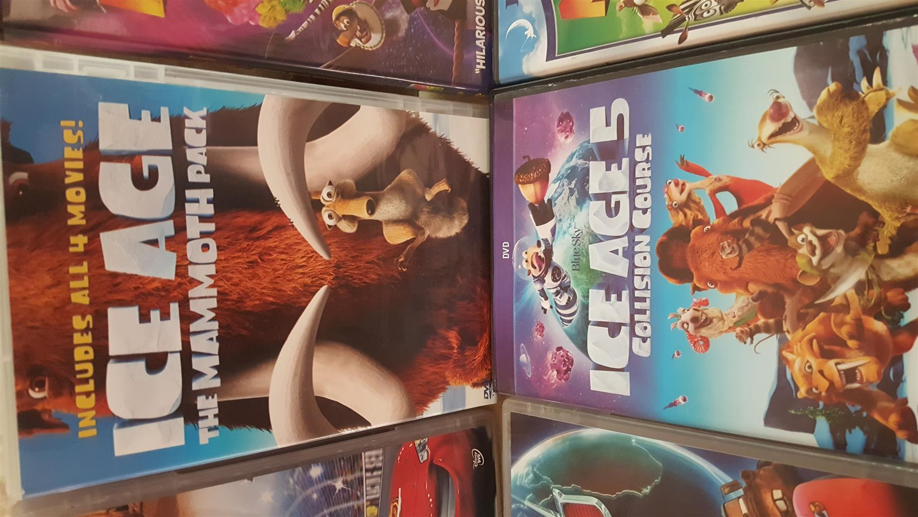 Collection of 14 children's dvds in as new condition.  Includes Ice Age Mammoth Pack, 2 x Cars, etc