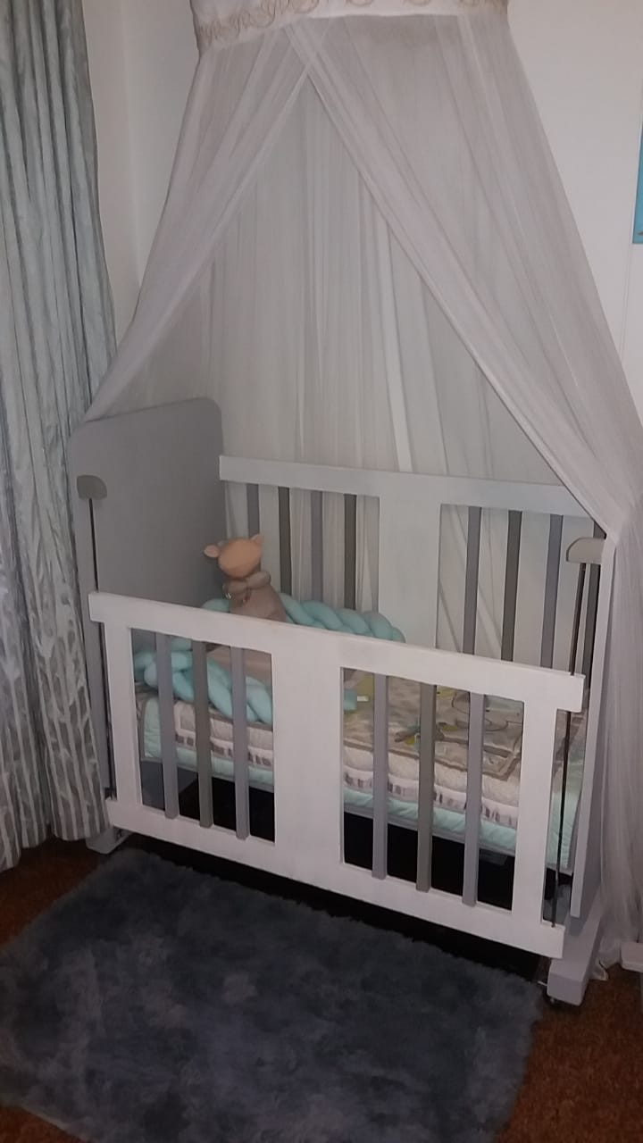 Wooden cot and horse