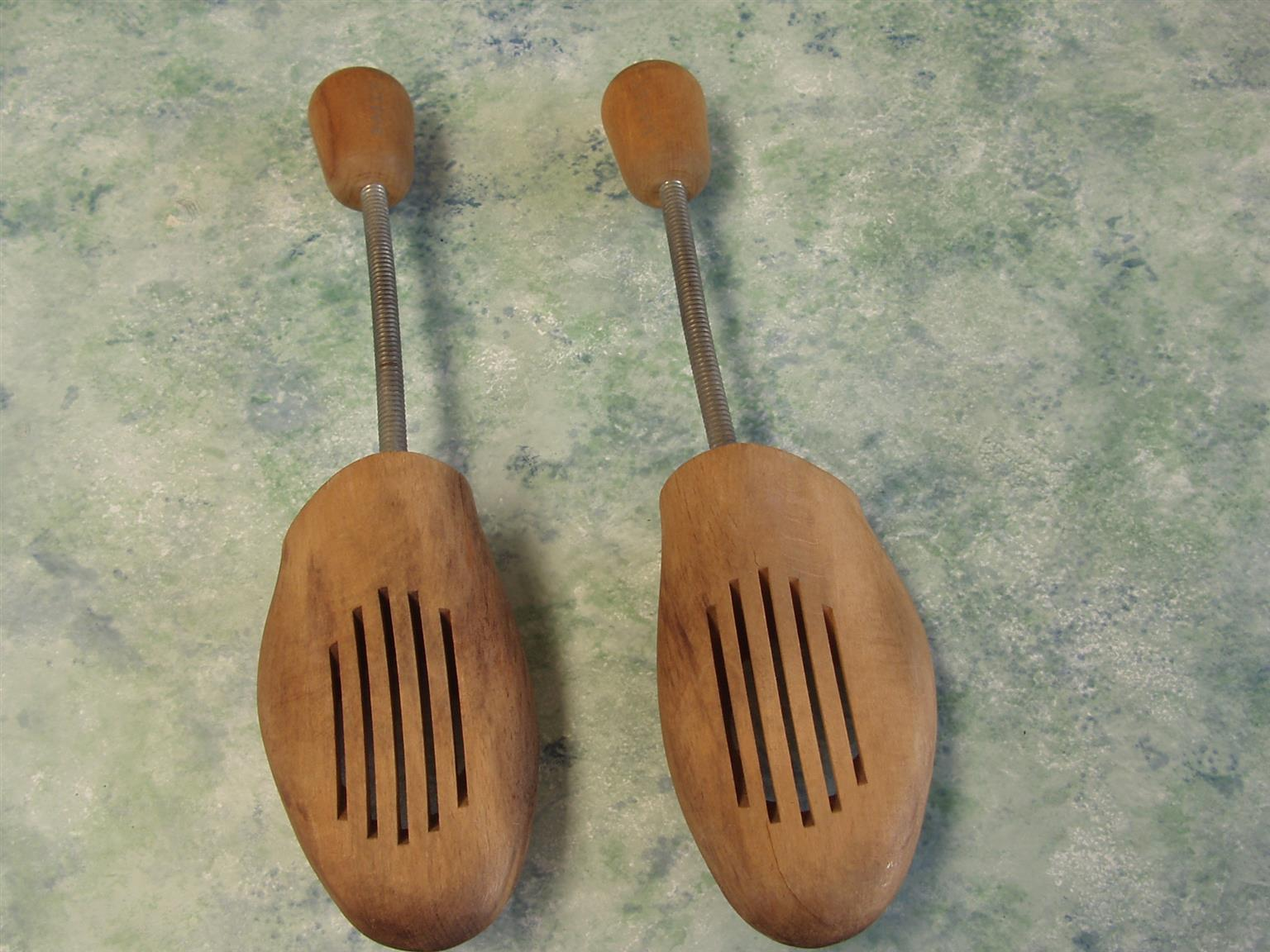 Pair of vintage wooden shoe stretchers with metal springs
