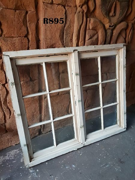 White window frame with glass and theft bars