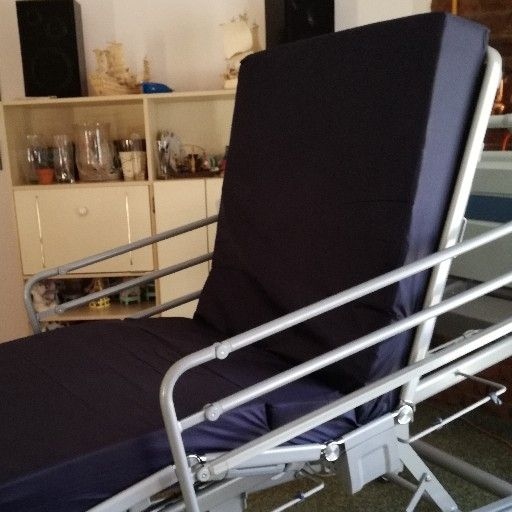 Hospital/ICU bed with overbed table and anaesthetic trolley with drawer