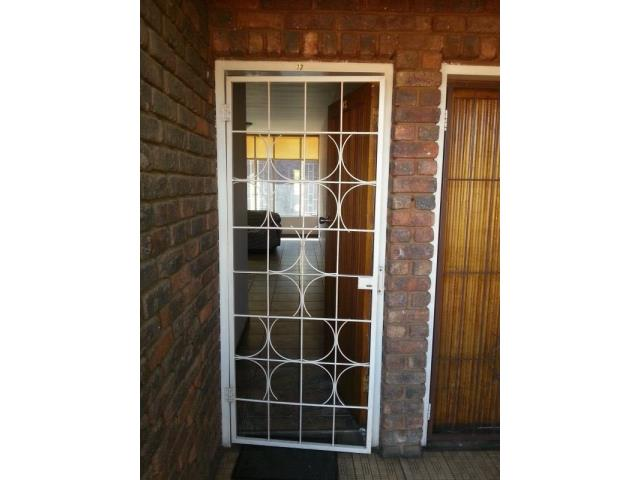This is apartment is in a secured complex with remote control security system gate it is situated in a very quite area of Pretoria gardens