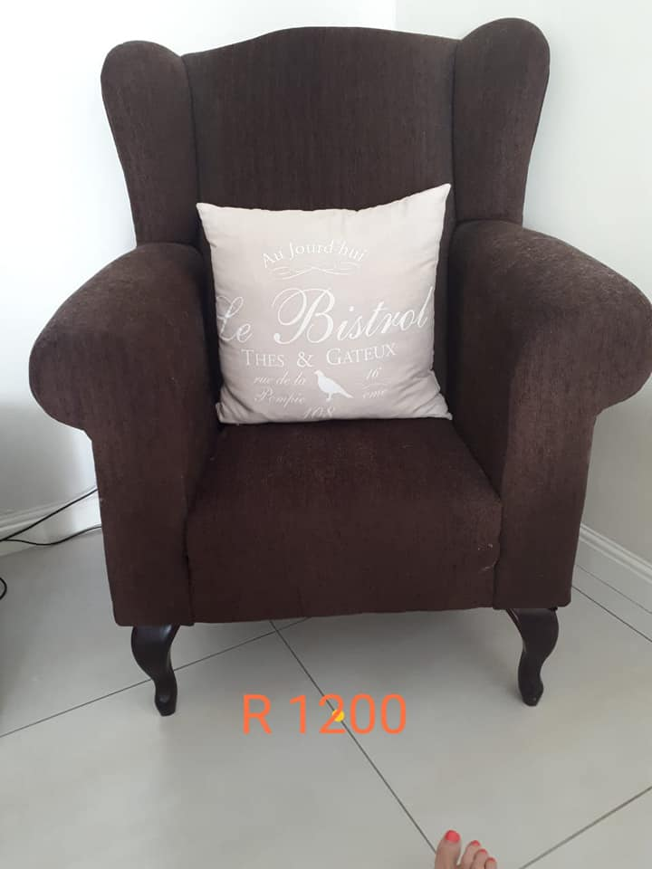 Dark brown suede chair with pillow for sale