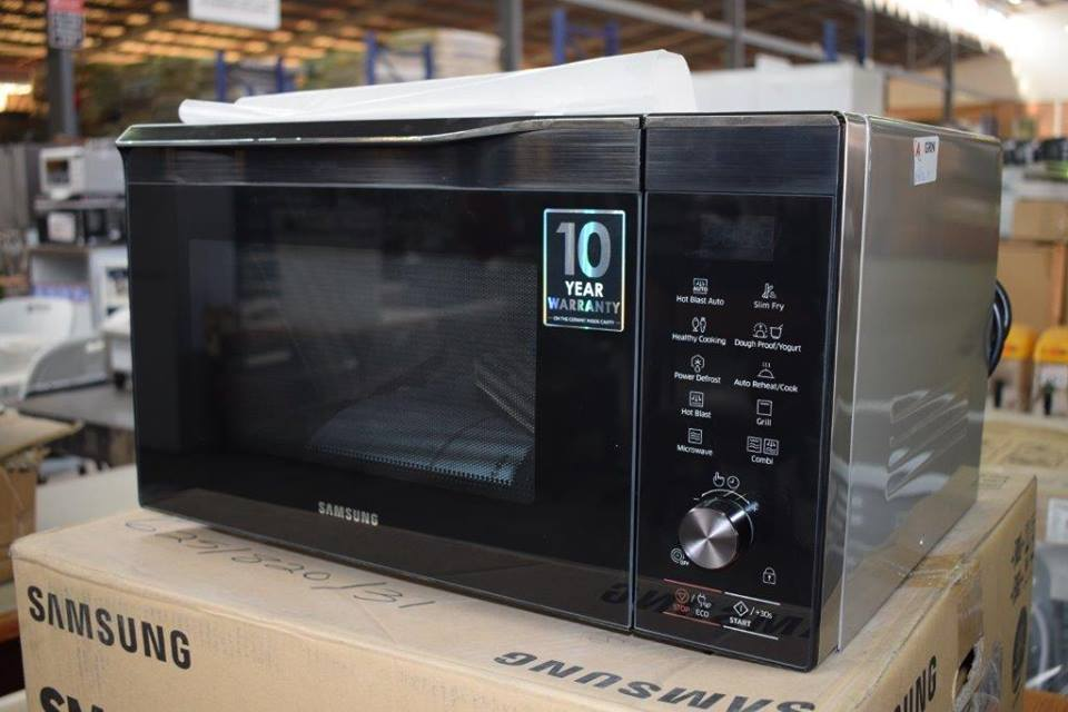Silver and black Samsung microwave