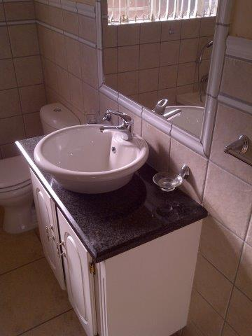 To Let R7 500 -00 PM Spacious executive flat in Western Extension. Occupation 1st October 2020