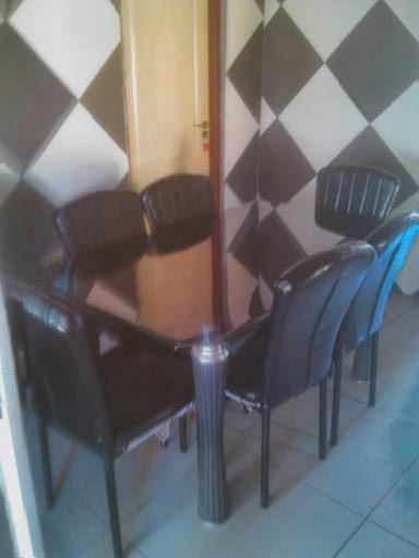 Selling a Glass Table and chairs