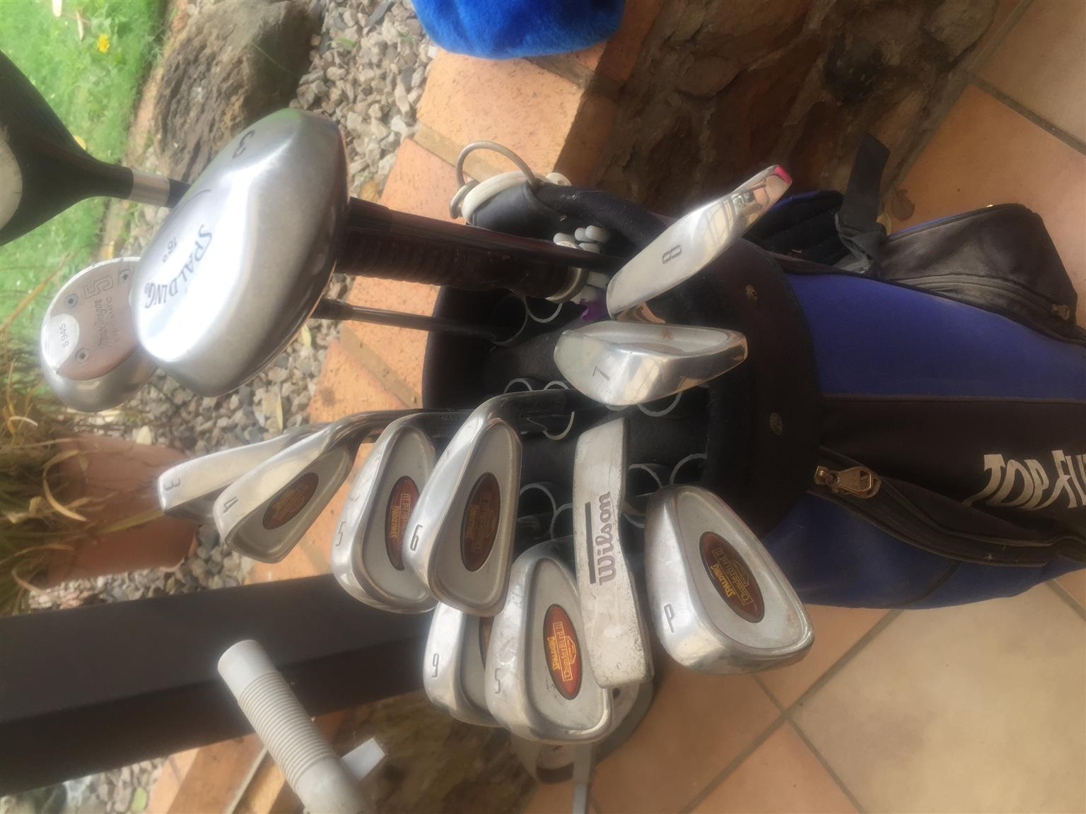 Golf clubs plus caddy and shoes