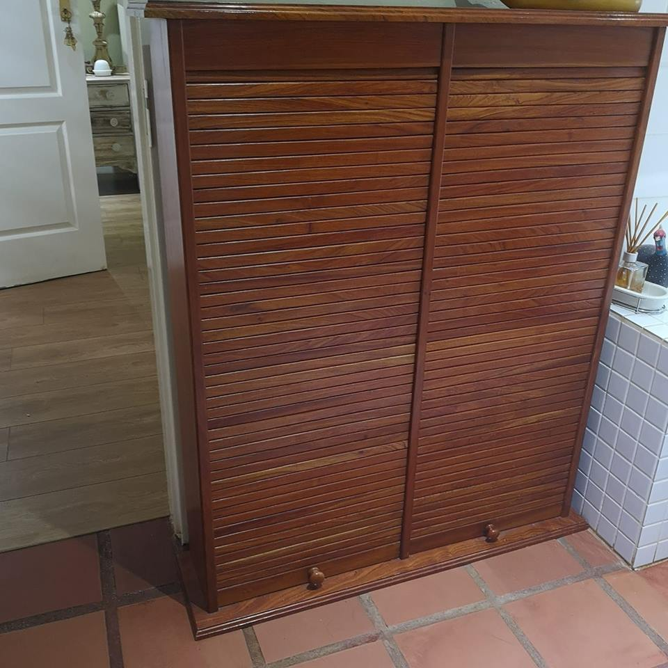 Cupboard for 150 CD's withbroll up doors.