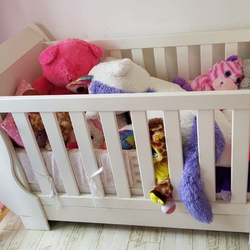 white wooden crib