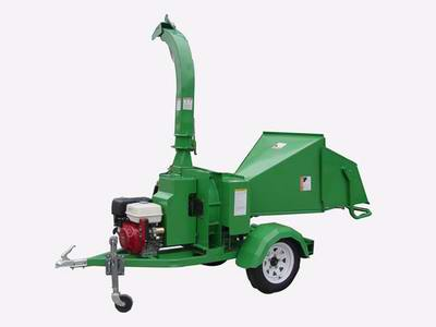 """Trailer Mounted Wood chipper , with self feeding system,3Bladed,5""""Diameter Capacity, powered by 25hp"""