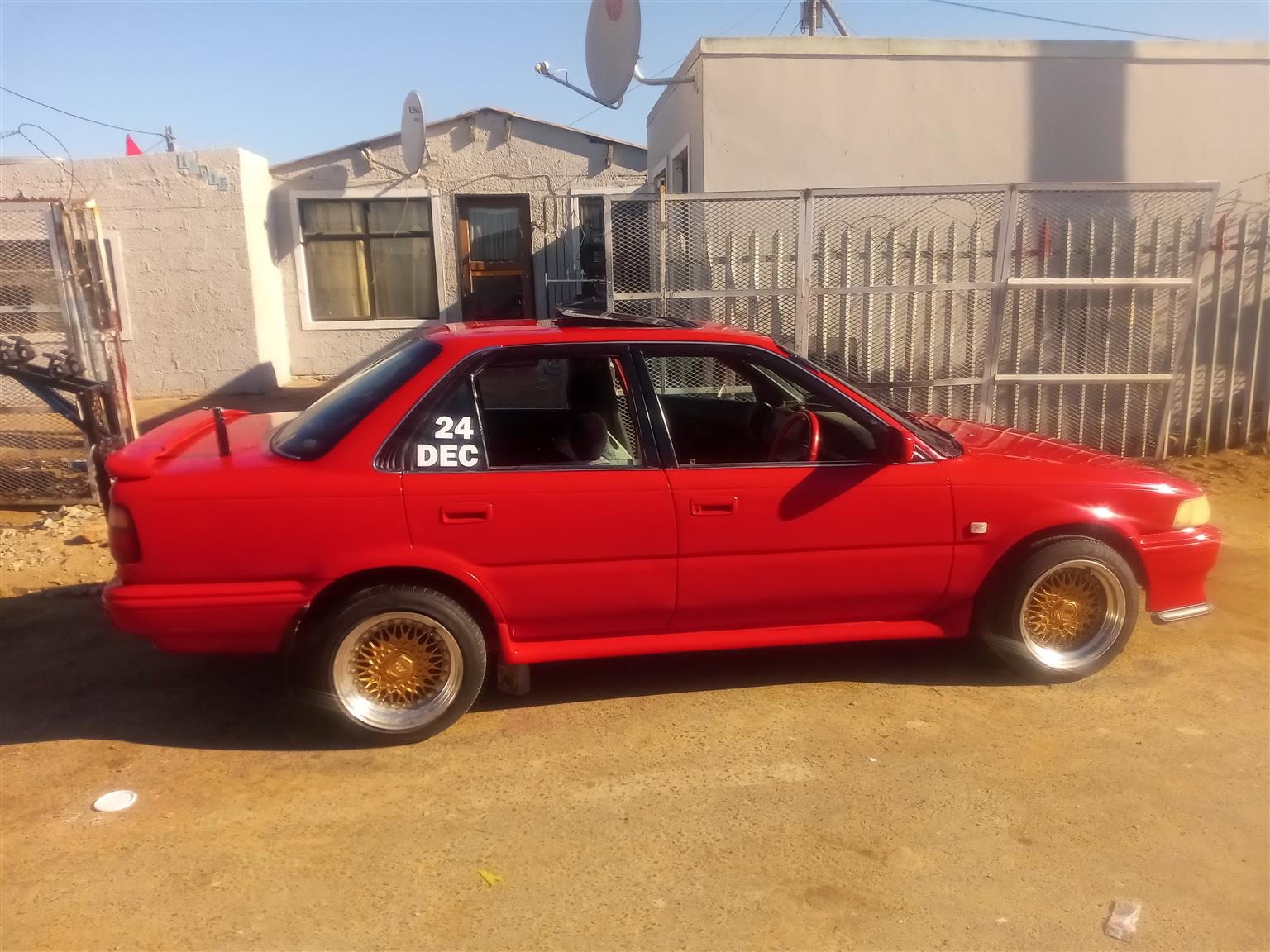 I'm selling my Toyota Corolla 180i red in colour
