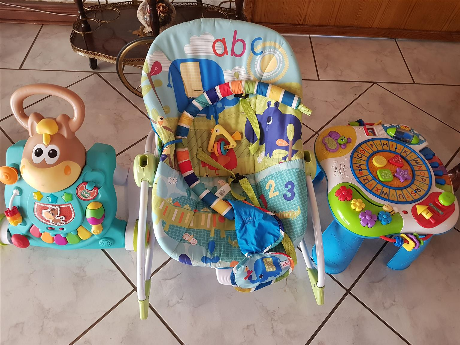 Baby rock chair, walker, play table and play mat