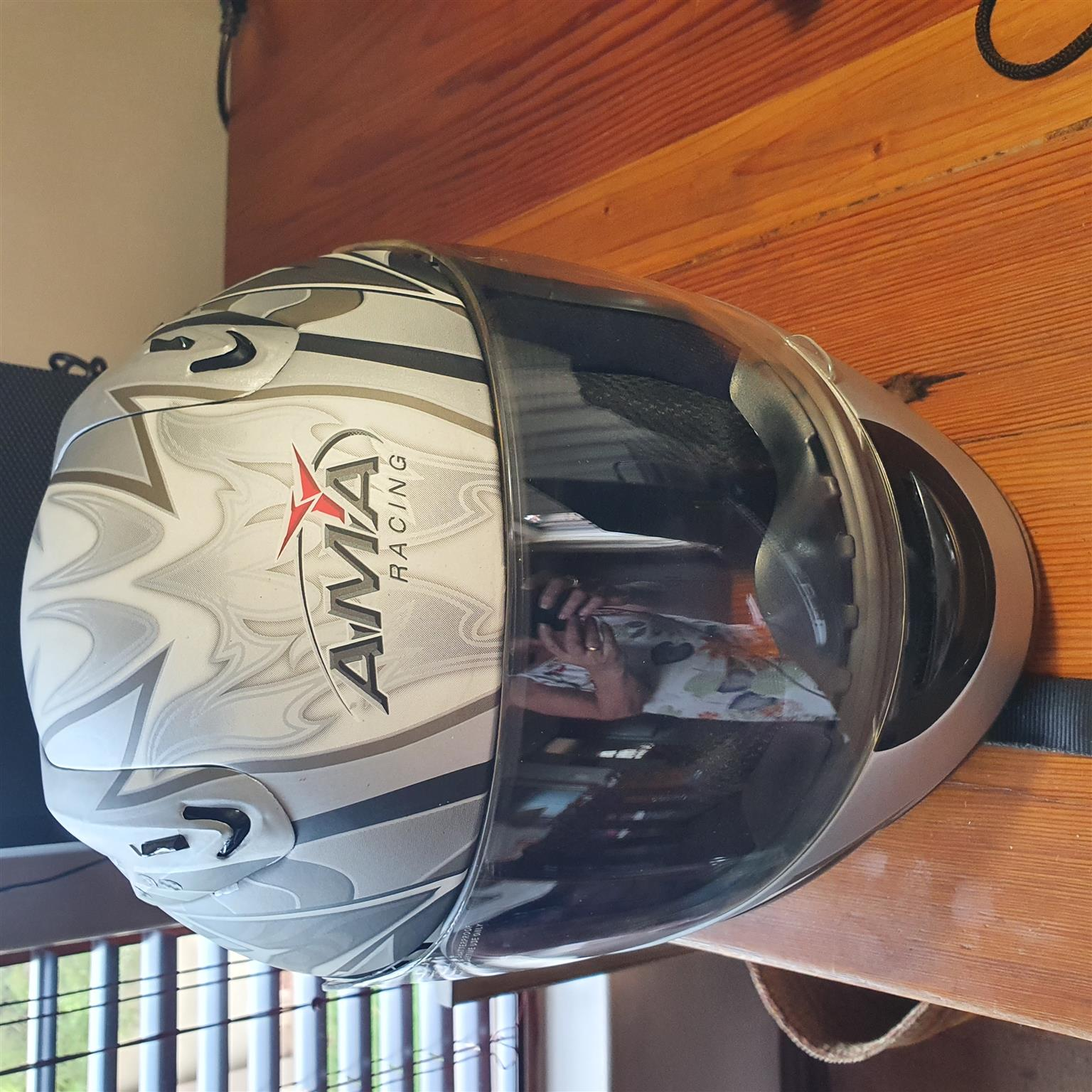 AMA full face motorcycle helmet.