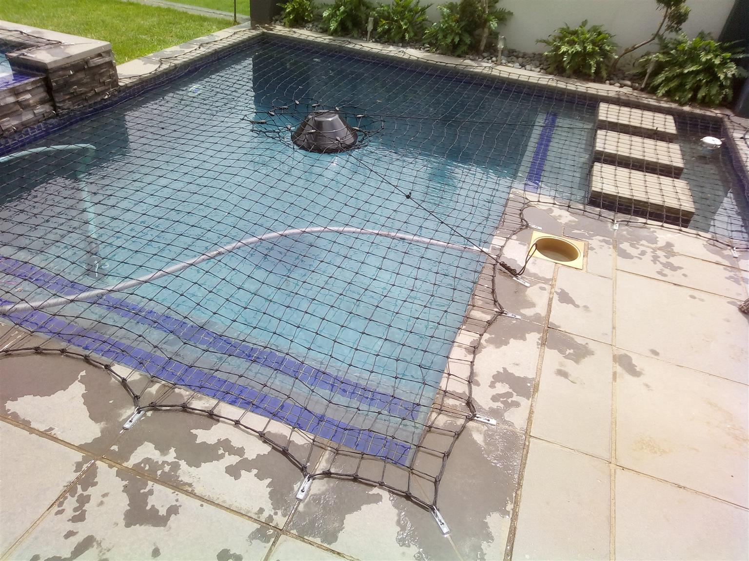 Swimming pool safety nets