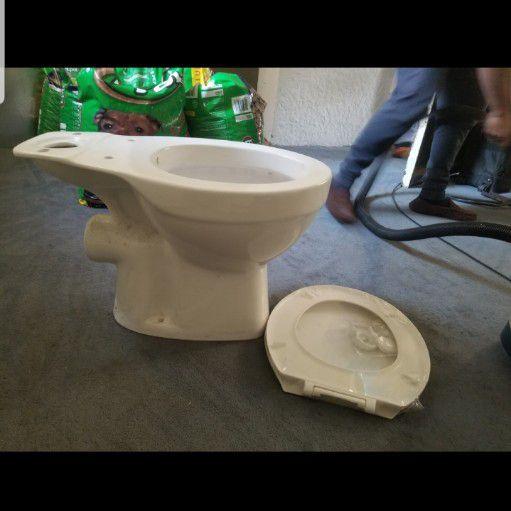 White toilet with toilet seat