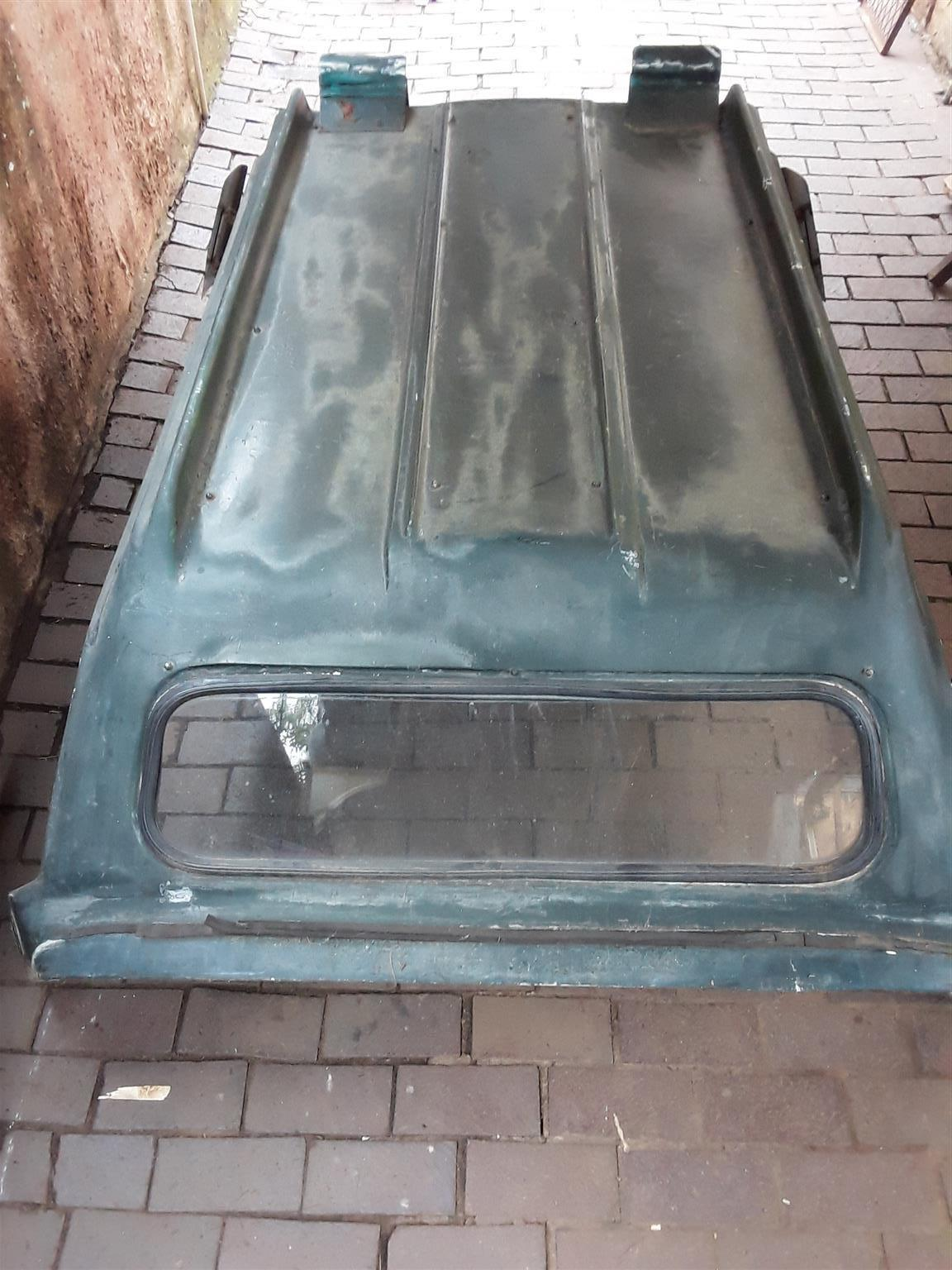 Bakkie Canopy with lockable tailgate and sliding real glass windows. Two saloon