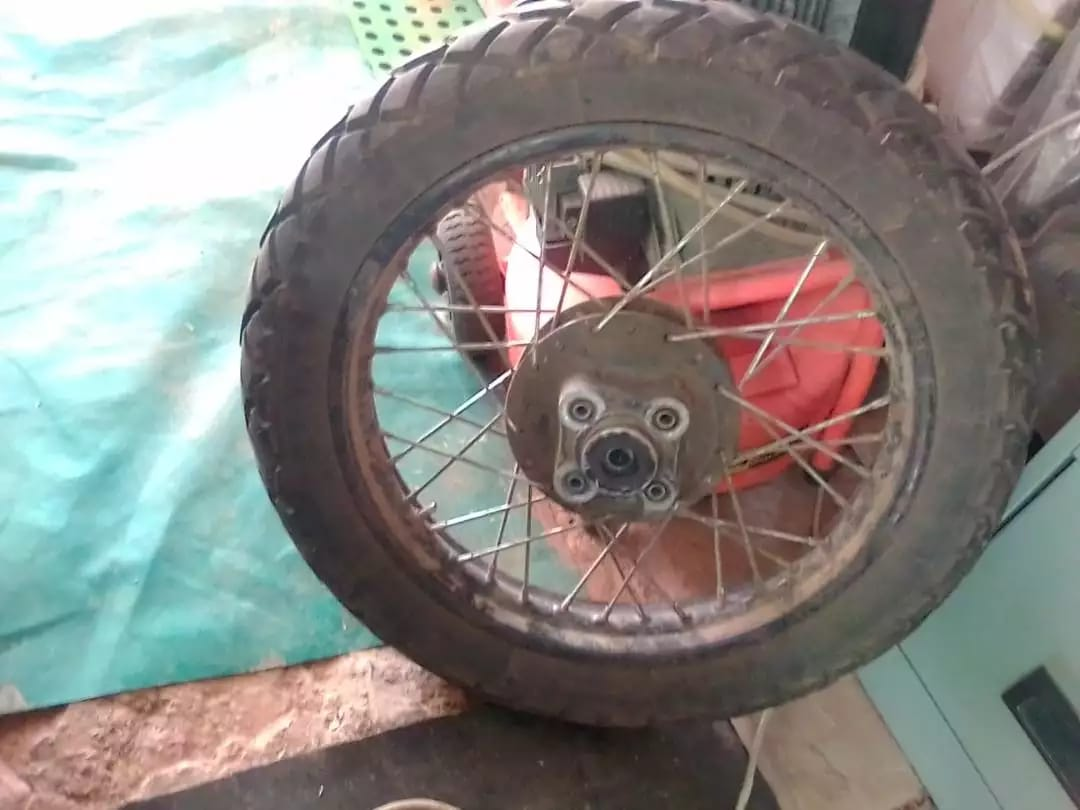 """18"""" Rear wheel with tyre and tube. Tyre is a Michelin with 90% life left on it! Brand New damper bushes installed. Take all for R 2,000 cash ONCO! GO AND PRICE IT AND YOU'LL SEE THAT IT IS A DEAL."""