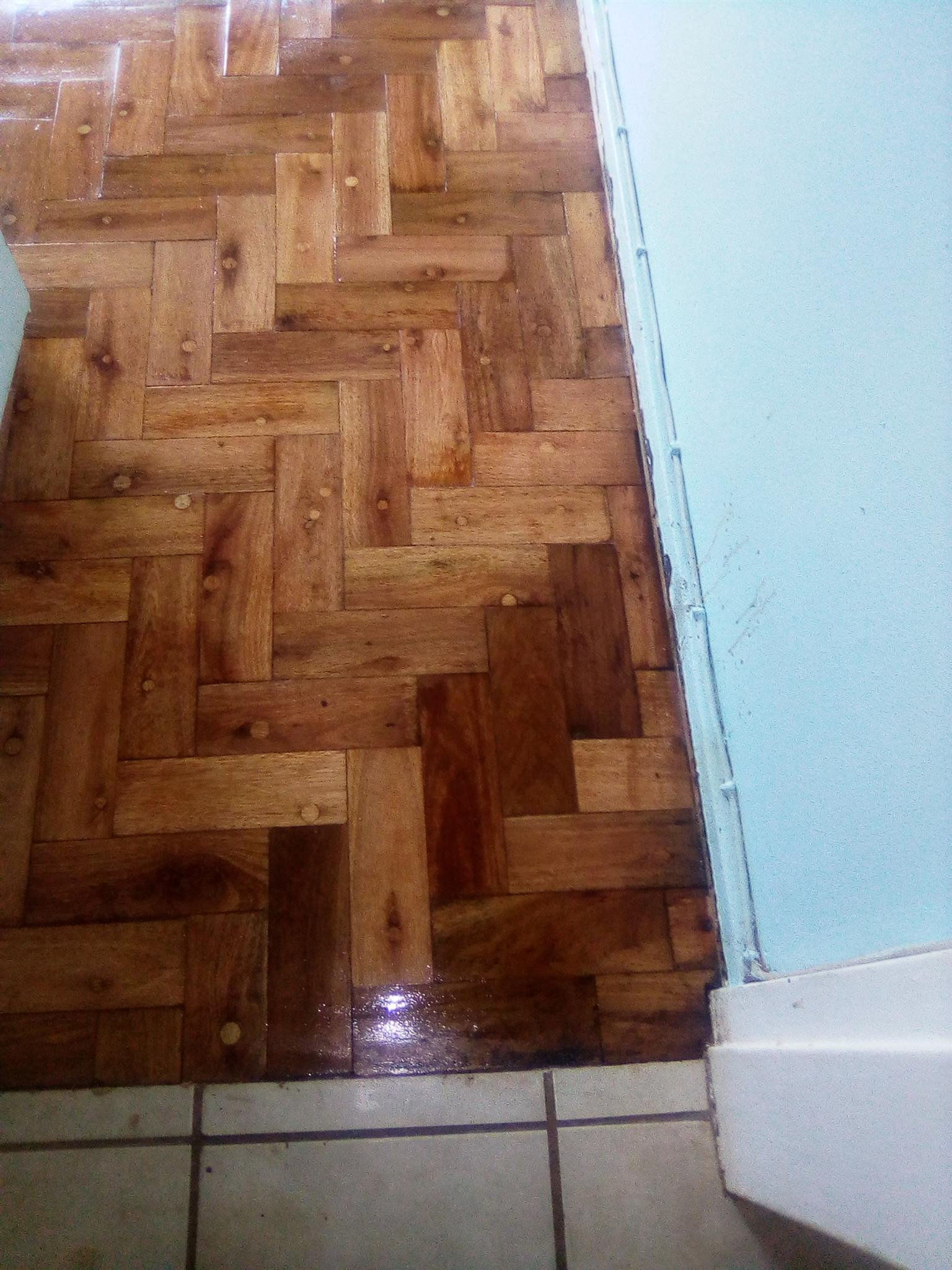 Wooden parquet floors installation sanding and sealing