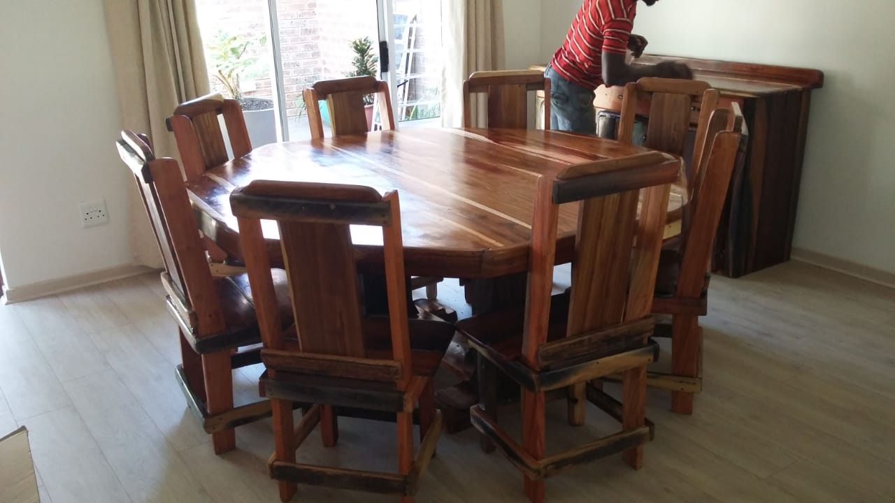 8 Piece dining room table & chairs