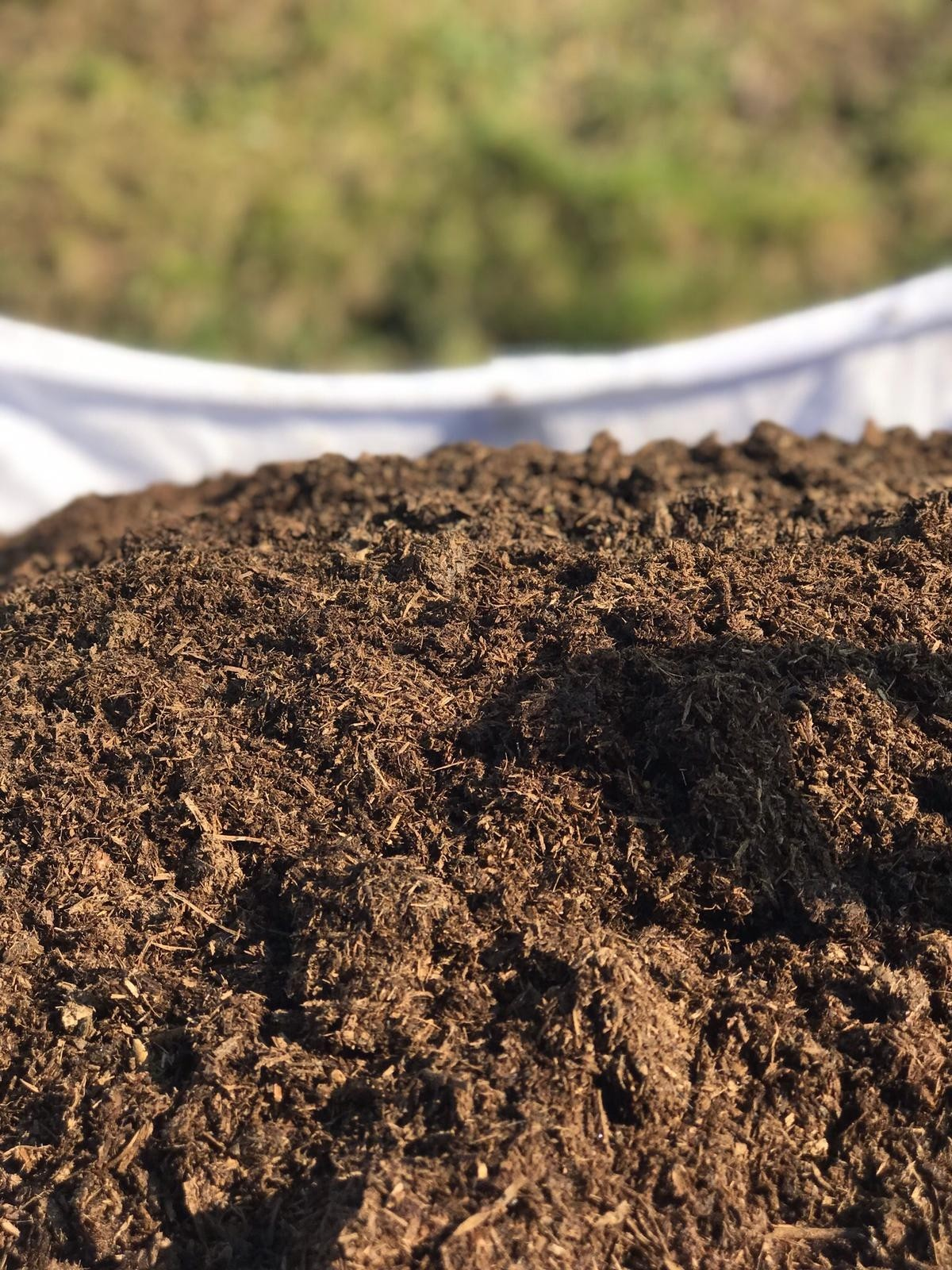 Compost,lawn dressing and top soil