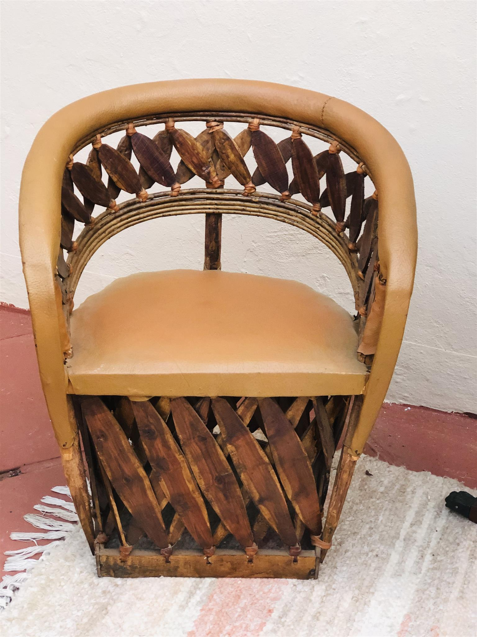 Pair of unique African carved tub chairs with genuine leather finish