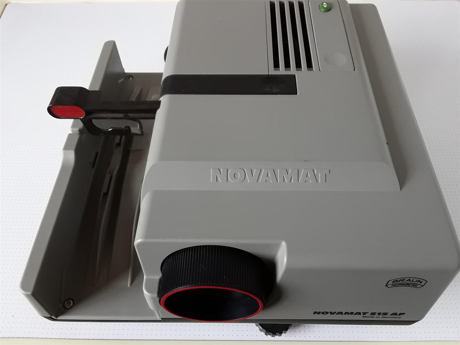 Projector NOVAMAT 515 AF Made in Germany. With built-in wired Remote. Adjustable angle. .
