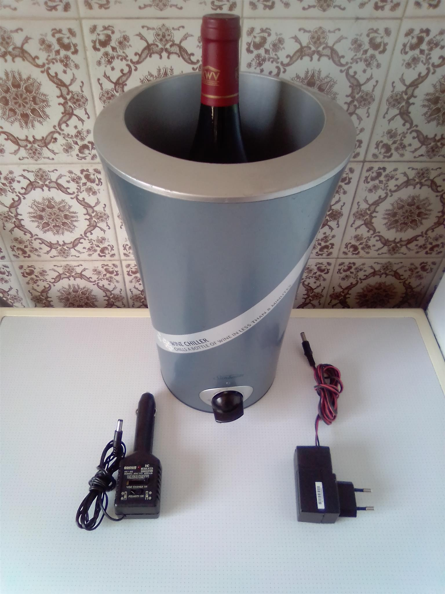 Wine Chiller Sunbeam with power adaptor. Child a bottle of wine in less then 8 minutes. I am in Orange Grove.