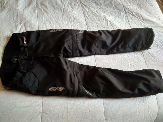 Various motorcycle clothing, jacket, pants, boots
