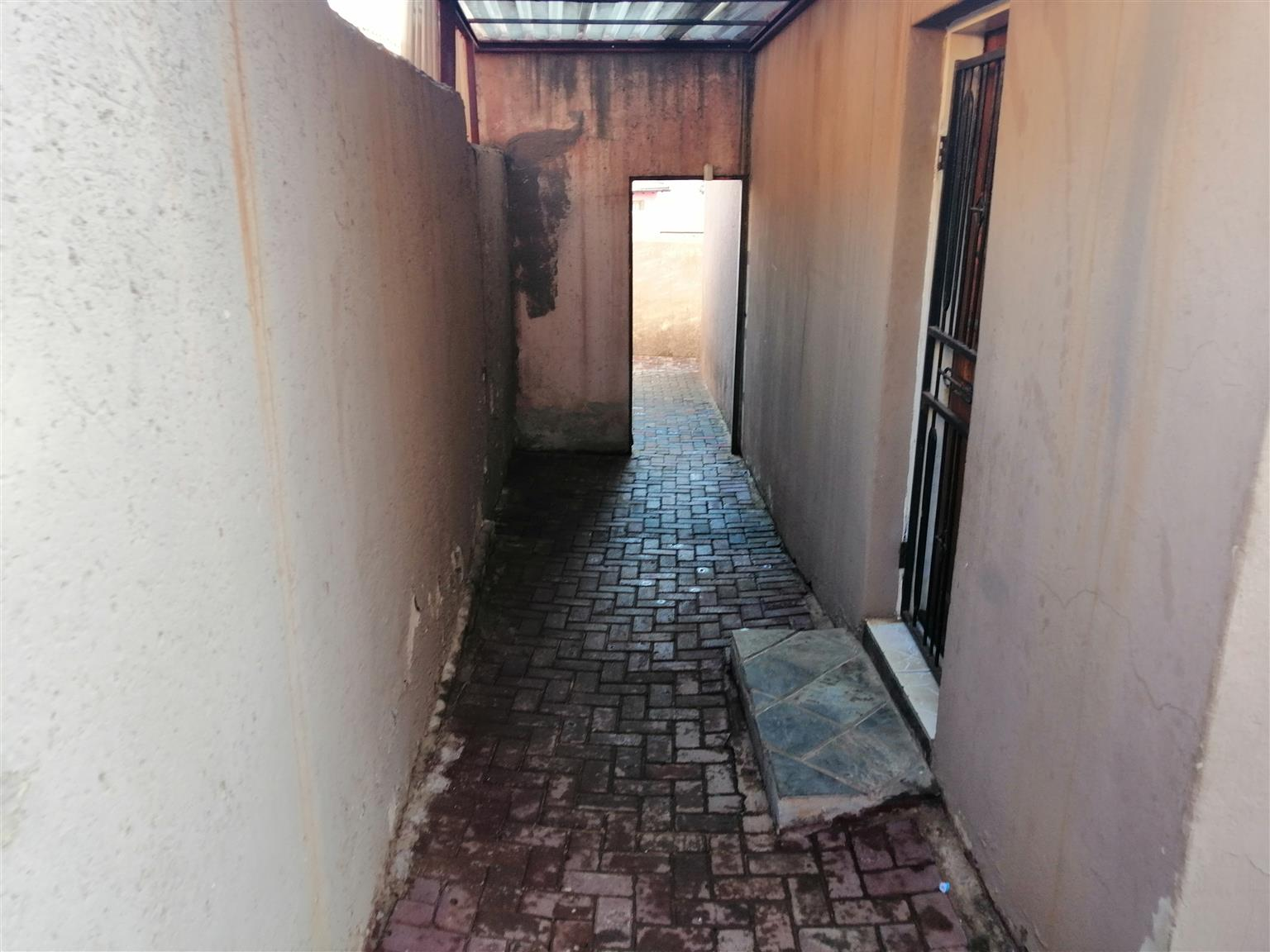 House for sale tembisa hospital view two badroom dining room seating room kitchen toilet bathroom and outside bachelor party rooms with shower and toilet with wall units fitted