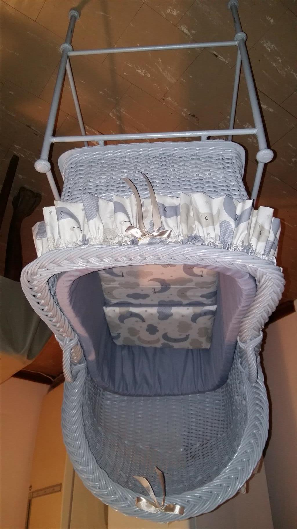 Baby cane crib with mattress, pillow, linen and steel stand.