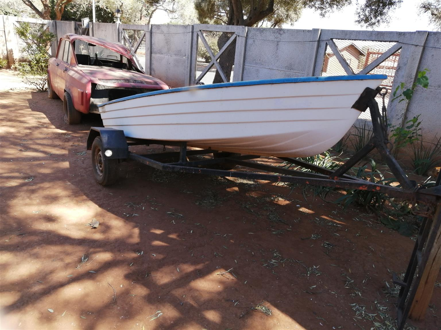 Boat on trailer with 6hp Johnson motor