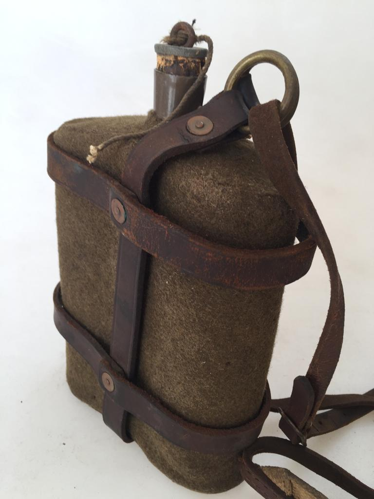 WWII water bottle – enamel with woollen cover and leather/canvas webbing carrier